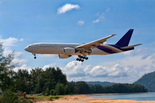 passenger aircraft over the beach