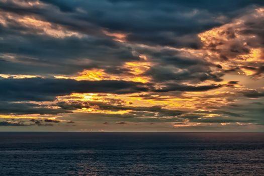 sunset on an overcast sea