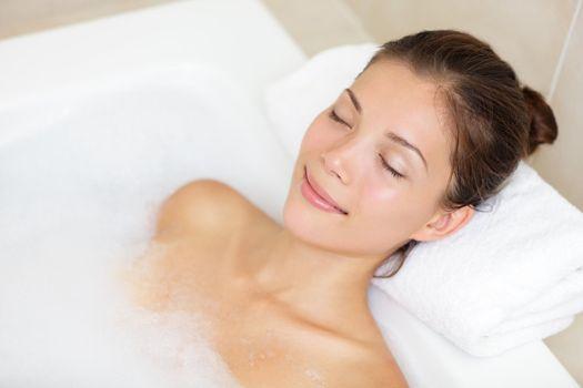 Bathing woman relaxing in bath