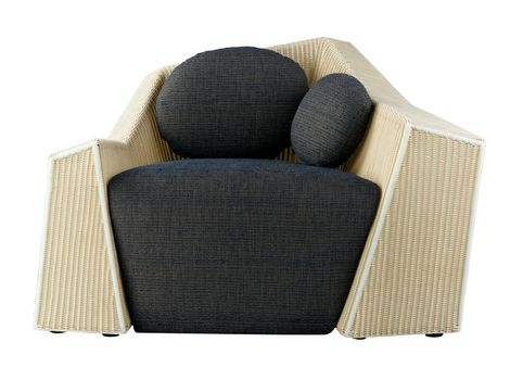 The art of rattan armchair with cushion and softness of the seat