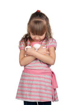 Happy little girl holding eggs over white background