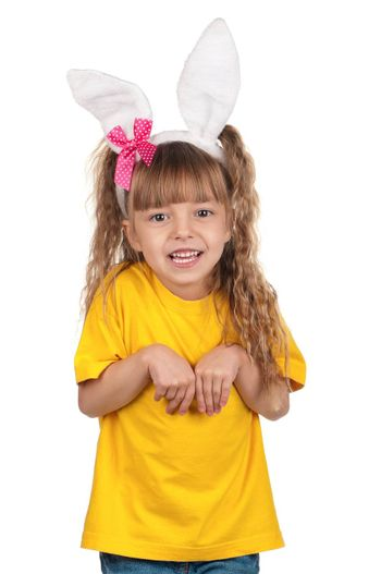 Portrait of happy little girl with bunny ears over white background.
