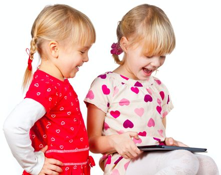 Children playing with a tablet computer