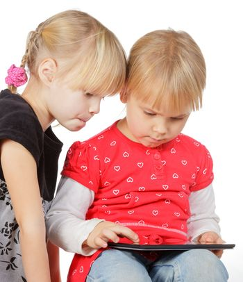 Girls playing with a tablet computer