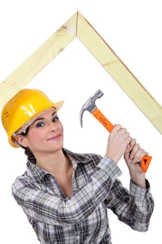 Woman building truss