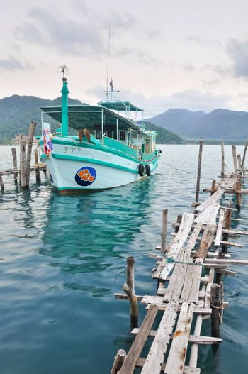 Local tour boat docked at Koh Chang island port, Thailand