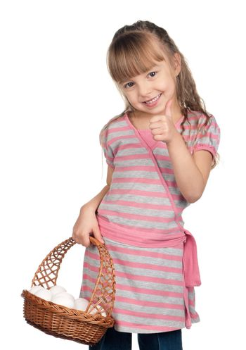 Happy little girl holding basket of eggs and giving you thumb up over white background