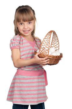 Happy little girl holding basket of eggs over white background