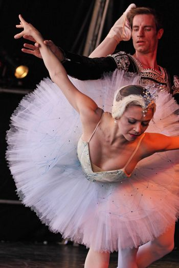 BRISTOL, ENGLAND - August 1: Megan Fairchild and Andrew Veyette of the New York City Ballet perform the White Swan pas de deux from Swan Lake in the Dance Village at the three day Harbour Festival in Bristol, England on August 1, 2010