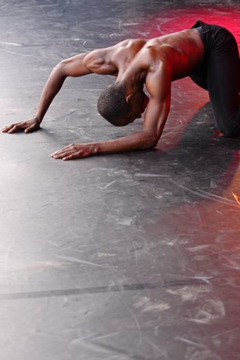 BRISTOL, ENGLAND - JULY 31: Samuel Roberts of the Alvin Ailey American Dance Theater performing 'Damn' in the Dance Village at the Harbour Festival in Bristol, England on July 31, 2010