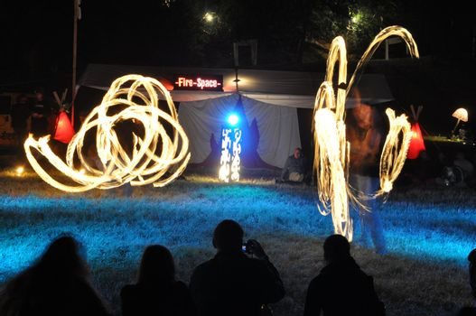 Artists playing with fire