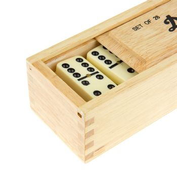 Domino in wooden box against the white background