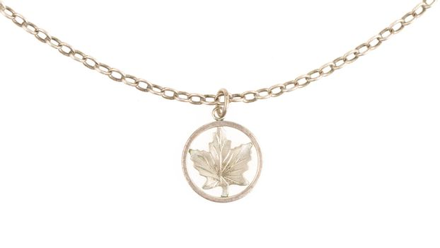 Old filthy silver hanger on a silver chain (maple leaf)