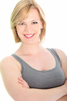 Vivacious young woman in a sleeveless top