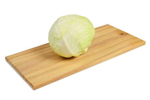 Cabbage on a cutting board. Isolated on white.