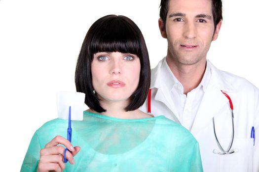 Hospital doctor and nurse holding a sterile gauze