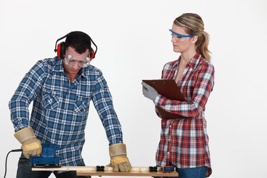 Man sawing a plank