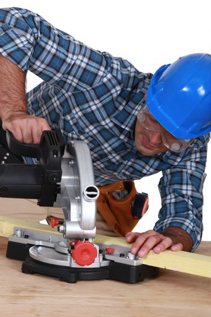 Carpenter with a circular saw