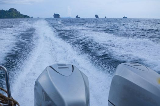 speedy boat prop wash, white wake on the blue ocean sea