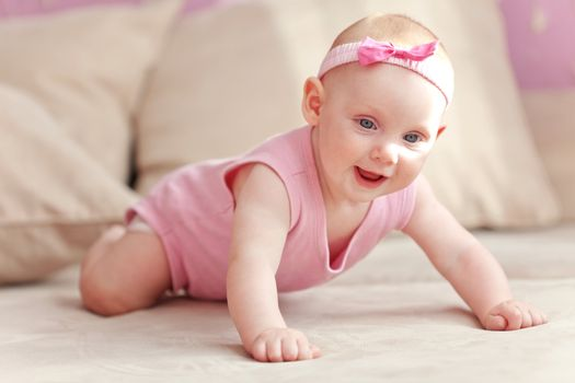 Picture of a crawling baby in diaper at home