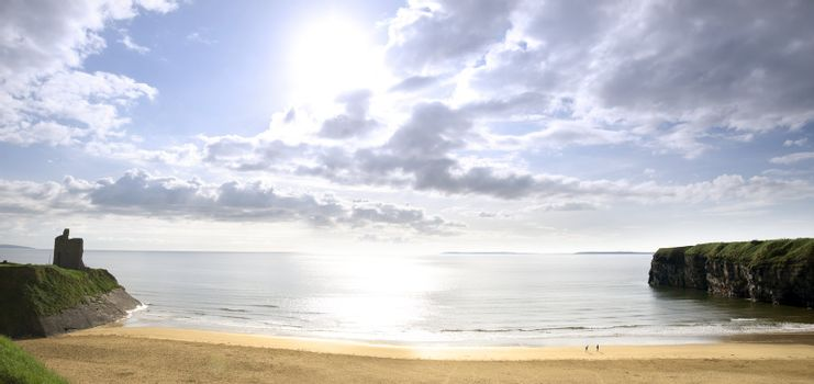 panorama of a Beautiful bright sun over the Ballybunion beach and castle in Ireland one summers day