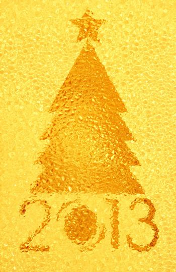 Closeup shot of Christmas tree crystal golden background