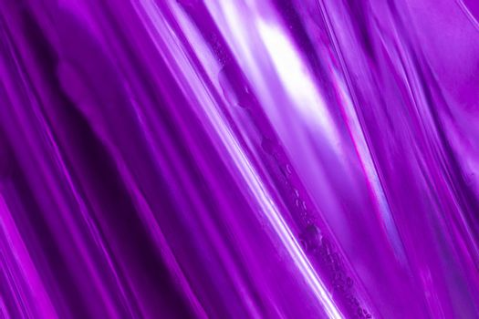 close-up shot of a abstract violet glass background