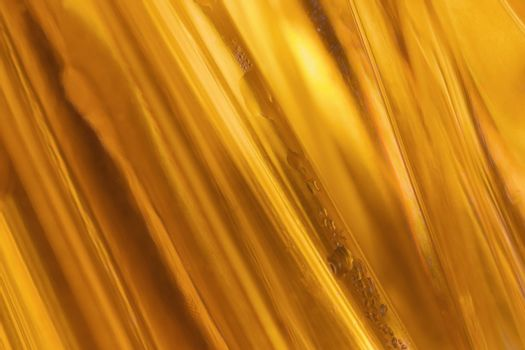 close-up shot of abstract golden glass bachground