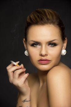 Beautiful seductive woman smoking