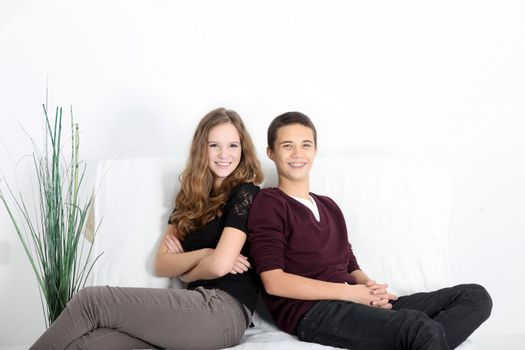 Teenaged couple relaxing at home