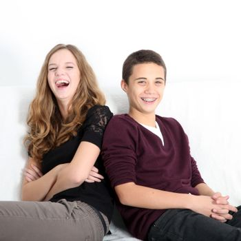 Laughing teenaged brother and sister