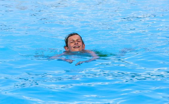 cute boy swimming in the pool
