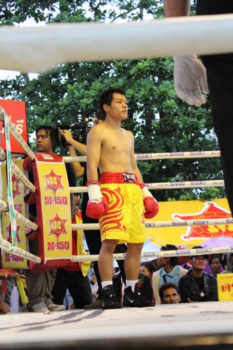 SURAT THANI, THAILAND - DECEMBER 14 : Decha Kokietgym wait to fight boxig with Chenyujie on December 14, 2012 in Surat Thani, Thailand.