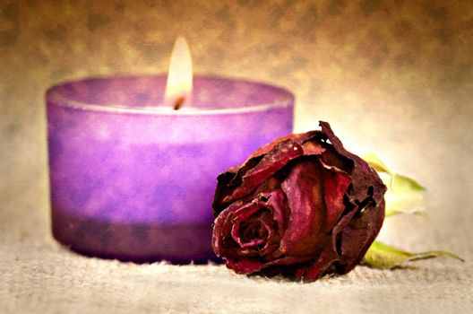 red rose and candle in the background with canvas effect