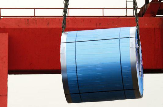lifting a roll of sheet metal