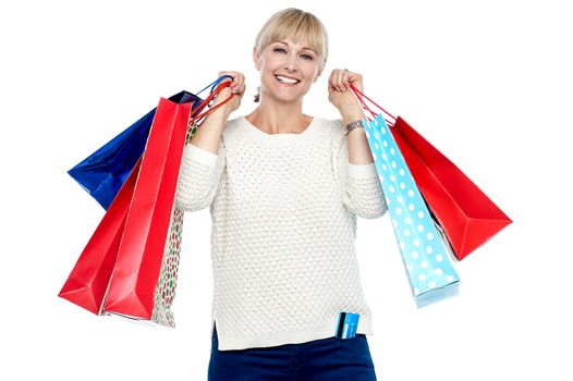 Portrait of a middle aged shopaholic woman