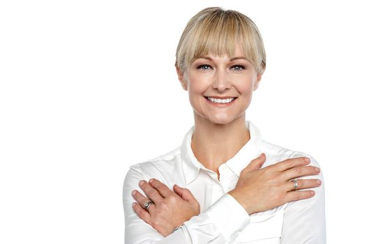 Businesswoman with arms crossed across her chest