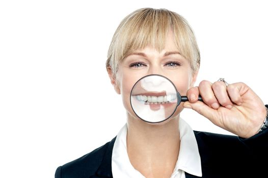 Caucasian woman playing with magnifying glass