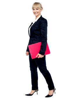 Energetic employee walking with her clipboard