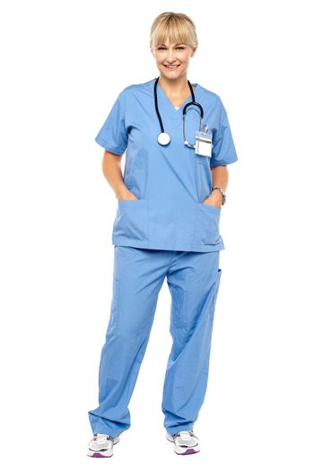 Cheerful relaxed female doctor in uniform