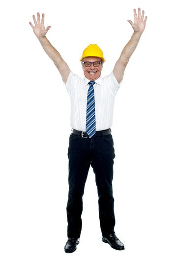 Contemporary construction engineer celebrating his success