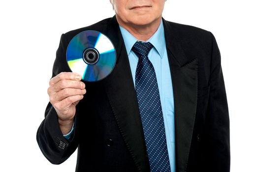 Cropped image of a male showing compact disk