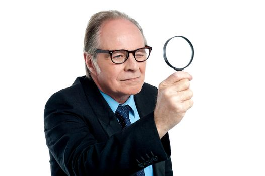 Detective  exploring through a magnifying glass