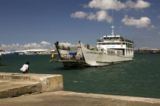 Feb. 2012 - Ferry Harbor, Bacolod City, Negros Oriental Island, Philippines - One of many inter island ferries transporting passengers and cargo among ports throughout the Philippine Islands. This ferry is a RORO, roll on roll off, called so because trucks, cars and buses can drive on and off of it. These ships are easy to capsize and sink if not loaded correctly.