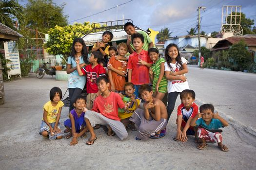 May 2012 - Bogo City, Cebu Island, Philippines - Portrait of a group of sixteen happy, smiling, healthy Filipino children. People in Bogo City are very friendly to foreigners and love to have their picture taken.
