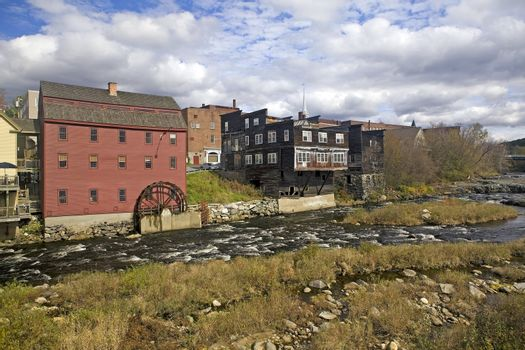 A restored vintage grain mill with water wheel on the Ammonoosuc River is still operating in Littleton, New Hampshire, USA. The mill is a popular tourist stop.
