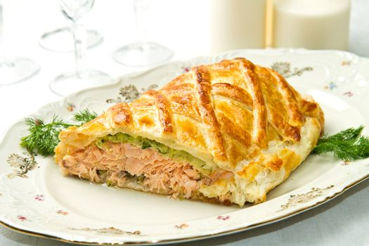 Traditional salmon in puff pastry with spinach and zucchini