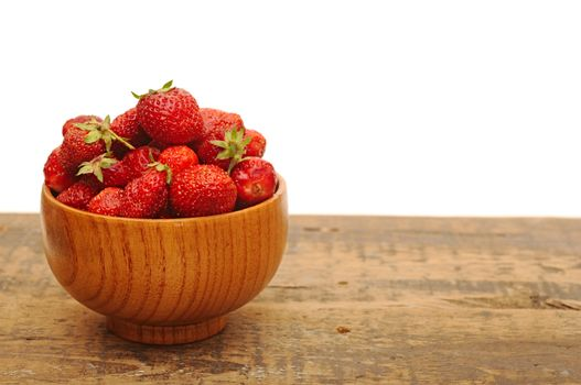 Red strawberries on old wood table