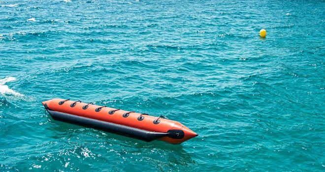 Moored floating banana boat at sea