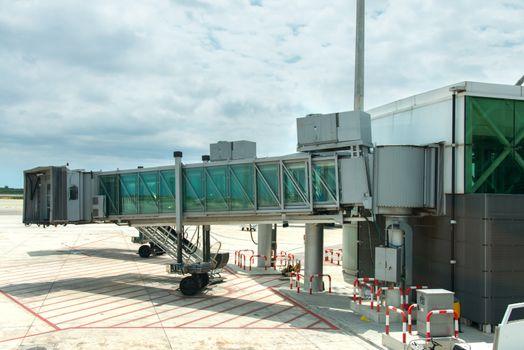 Modern glass airport ramp overcast